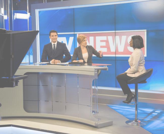 TV host interviewing media spokesperson in tv studio