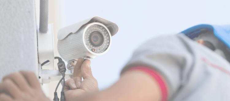Security Camera Installer installing a CCTV camera